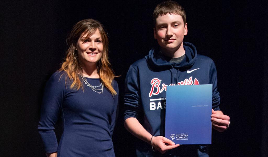 Athlete of Influence Scholarship winner accepts award